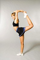 Teenage girl lifting up one leg