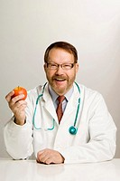 Doctor holding an apple (thumbnail)
