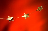 Christmas stars hanging in a line