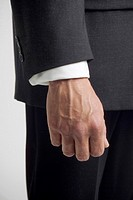 Side view shot of businessman's hand, midsection