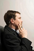 Businessman in deep thought (thumbnail)