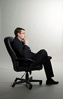 Businessman contemplating, side view (thumbnail)