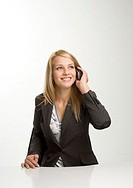 Businesswoman talking on the mobile (thumbnail)