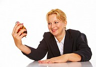 Happy businesswoman holding an alarm clock