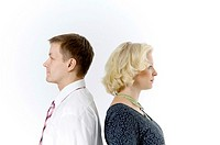 Businessman and businesswoman standing with their back facing each other