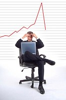 Businessman with laptop and line chart indicating revenue drop