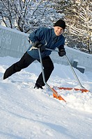 Man removing snow with snow cleaner