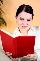 Woman smiling while reading