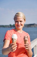 Woman holding coned ice-cream