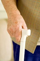 Close up of senior woman's hand using a walking stick