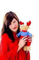 Beautiful woman holding soft toy
