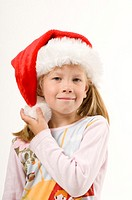 Girl with santa hat smiling at the camera