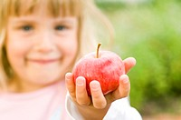 Girl holding red apple (thumbnail)