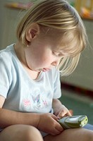 Girl playing with mobile phone (thumbnail)