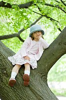 Girl posing on tree branch