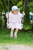 Girl sitting on swing