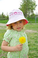 Girl with hat holding a flower