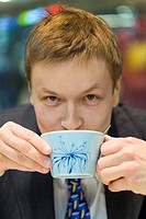 Businessman drinking a cup of coffee (thumbnail)