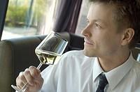 Businessman enjoying a glass of champagne