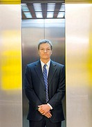 Businessman in the elevator