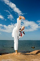 Woman giving a high kick
