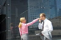 Businessman kissing businesswoman´s hand