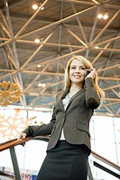 Businesswoman talking on the mobile at the airport terminal (thumbnail)