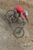 Mountain Biker Going Downhill