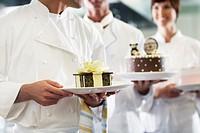 Chefs Holding Desserts