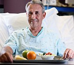 Middle Aged Man in Hospital Bed (thumbnail)