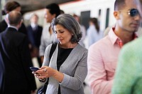 Woman Text Messaging in Subway Station