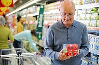 Man Shopping for Yogurt in Supermarket