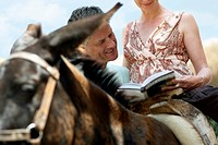 Vacationing Couple Consulting Guidebook