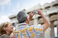 Couple Using Digital Camera at Ancient Temple