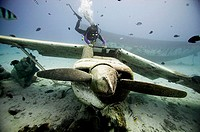 Scuba diver and Airplane wreck. Papeete. French Polynesia