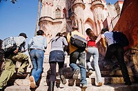 Hispanic college students walking up steps