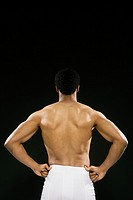 Rear view of African American man wearing towel