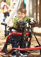 Physically disabled boy at playground (thumbnail)