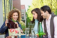 Hispanic woman showing friends new purchase