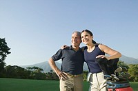 Hispanic couple on golf course