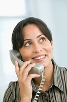 Hispanic businesswoman talking on telephone (thumbnail)