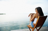 South American woman in deck chair on dock (thumbnail)
