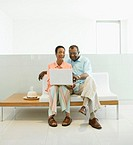 Senior African couple looking at laptop
