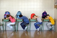 Students Laying with Heads Down on Desks