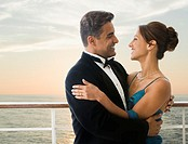 Hispanic couple in eveningwear on ship