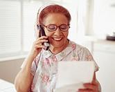 Senior Hispanic woman talking on telephone
