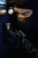 Thief opening a safe