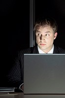 Man snooping through laptop computer