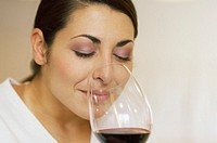 Woman smelling aroma of red wine