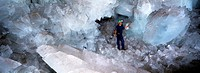 Cave of Crystals  Geologist standing in the Cave of Crystals Cueva de los Cristales in Naica Mine, Chihuahua, Mexico  The crystals are the largest kno...